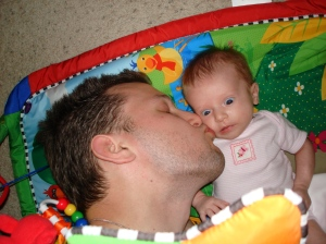 Daddy kissing baby